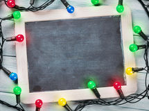 Christmas chalkboard and lights. Top view with copy space for your text Stock Photography