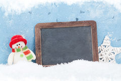 Christmas chalkboard, snowman and decor Royalty Free Stock Photography