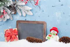 Christmas chalkboard, snowman and fir tree Stock Photo