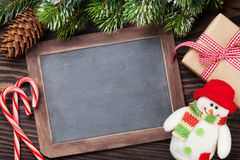 Christmas chalkboard, snowman and tree Stock Photography