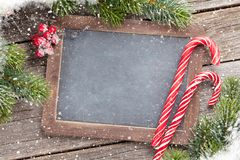 Christmas chalkboard for your greetings Stock Images