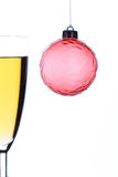 Christmas champagne. Christmas ornament and glass with champagne Stock Photography