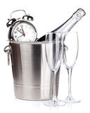 Christmas champagne with alarm clock in bucket and empty glasses Royalty Free Stock Photo