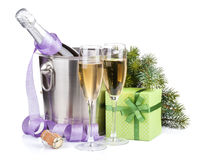 Christmas champagne with alarm clock in bucket and gift box Royalty Free Stock Photography