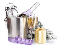 Christmas champagne with alarm clock in bucket and gift box Royalty Free Stock Image