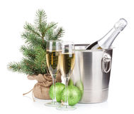Christmas champagne bottle in bucket, glasses and fir tree Royalty Free Stock Photo