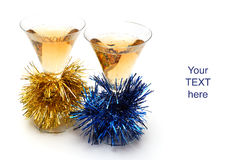 Christmas champagne and Christmas-tree decorations. On white background Royalty Free Stock Photography