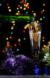 Christmas champagne in dark Stock Images