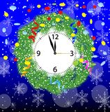 Christmas chaplet with a clock, serpentine and confetti Stock Image