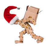 Christmas character carrying a large box Royalty Free Stock Image