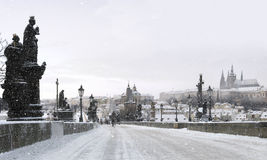 Christmas on Charles bridge. Famous Prague Charles bridge during snowfall Stock Photography
