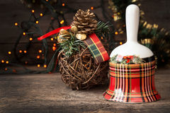 Christmas checkered bell on wooden table against background Chri Stock Photos