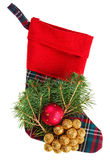 Christmas checkered stocking with fir branch Royalty Free Stock Photo