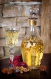 Christmas Cheer. Decanter and glass on a wooden table with decorative objects, slight soft focus effect stock photography