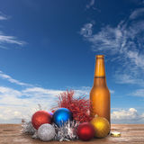 Christmas cheer - cold beer and baubles, sunshine sky. Australia maybe! Royalty Free Stock Image