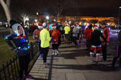 Christmas Cheer at the Ellipse. Photo of jogging group at the ellipse in washington dc next to the white house on 12/11/14.  These people are spreading christmas Royalty Free Stock Photos