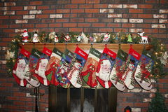 Christmas cheer. Christmas stockings hung by the red brick fireplace.christmas eve  waiting for the family.   Santa and his raindeers Stock Photography