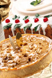 Christmas cheesecake caramel with nuts on the decorated table Stock Photo