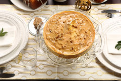 Christmas cheesecake caramel with nuts on the decorated table Royalty Free Stock Photos