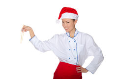 Christmas chef with chopsticks Stock Images