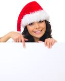 Christmas chick with board. Beautiful christmas woman in santa hat holding empty board Stock Images