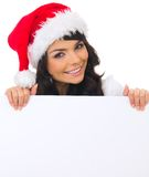 Christmas chick with board. Beautiful christmas woman in santa hat holding empty board Royalty Free Stock Photo