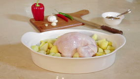 Christmas chicken for roasting on table stock video