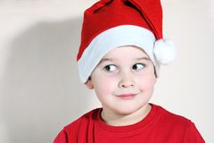Christmas child. Beautiful child with Christmas hat stock photo