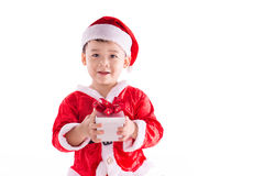 Christmas Child Boy in Santa Hat and Gift Stock Image