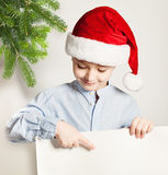 Christmas Child. Cute Small Boy and White Banner Stock Photo