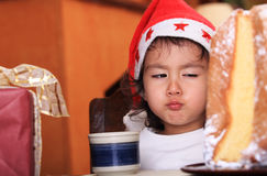 Christmas child with funny expression Royalty Free Stock Photography