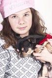 Christmas child girl with dog. Christmas girl with dog standing for the christmas tree Royalty Free Stock Photos
