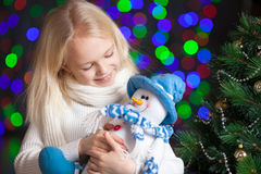 Christmas child girl over festive background Royalty Free Stock Photos