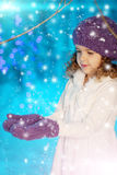 Christmas child girl on winter tree background, snow, snowflakes Stock Image