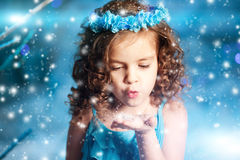 Christmas child girl on winter tree background, snow, snowflakes Royalty Free Stock Photos