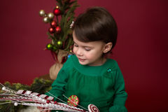 Christmas Child: Happy Girl on Red Background Stock Photography