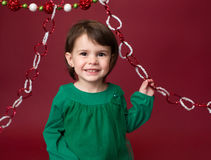 Christmas Child: Happy Girl on Red Background Stock Photos