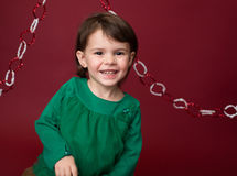 Christmas Child: Happy Girl on Red Background Stock Photo