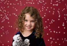 Christmas Child: Happy Girl on Red Background Royalty Free Stock Photography