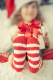Christmas. Child holding Christmas gift. Xmas holiday concept Royalty Free Stock Photography