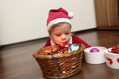 Christmas child lying on floor Stock Photography