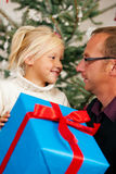 Christmas - child receiving a gift Royalty Free Stock Images