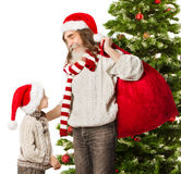 Christmas child, Santa Claus grandfather with red  Stock Photo