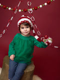 Christmas Child in Santa Elf Hat Royalty Free Stock Photo