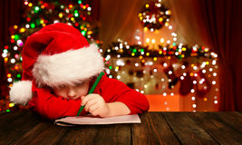 Christmas Child Write Letter Santa Claus, Kid In Hat Writing Royalty Free Stock Images