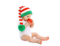 Christmas and childhood concept - baby in bright knitted gnome Royalty Free Stock Photography
