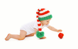 Christmas and childhood concept - baby in bright knitted gnome Royalty Free Stock Images