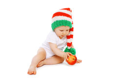 Christmas and childhood concept - little baby in bright hat Stock Photo