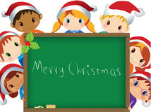 Christmas children around chalkboard Stock Photos