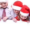 Christmas children with a banner Royalty Free Stock Photos